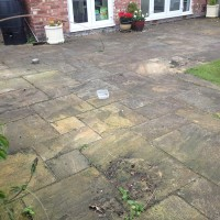 Indian sandstone patio before cleaning by www.cleaning-service.uk.com taken in skelmersdale