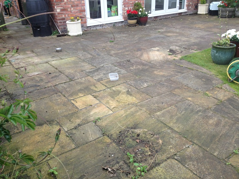 Indian sandstone , Black limestone patio before cleaning by www.cleaning-service.uk.com taken in chester cheshire.