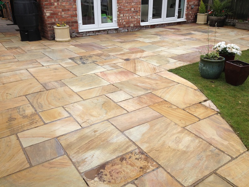 Image of Indian sandstone , Black limestone patio after cleaning liverpool merseyside