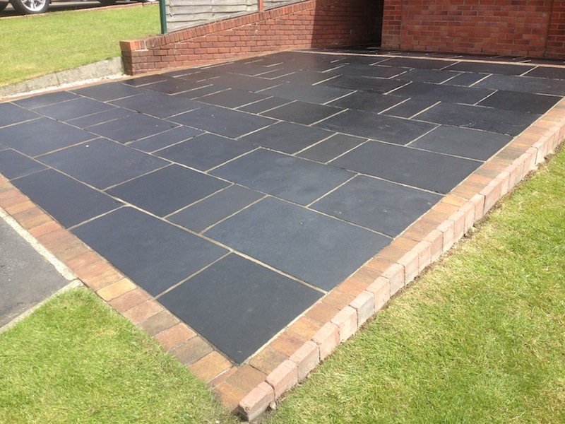 Indian sandstone , Black limestone patio in Cheshire after cleaning and sealing