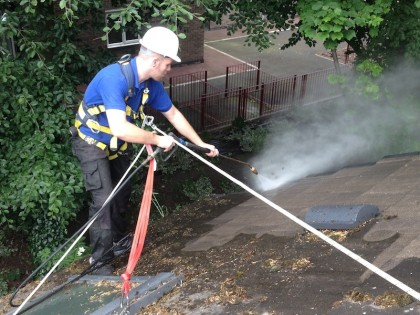 Jet washing company Liverpool Merseyside a roof cleaning image. www.cleaning-service.uk.com