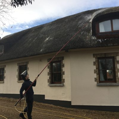 Thatched Roof Maintenance | Cleaning Moss from a Thatched Roof